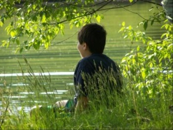 Child at edge of pond