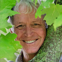 portrait of Lang Elliott among maple leaves