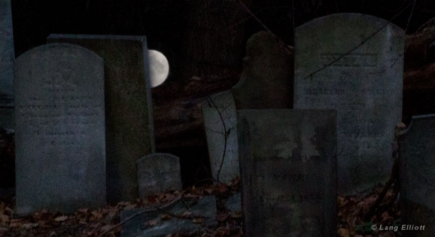 photo of graveyard at night with full moon