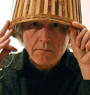 photo of Lang with a basket on his head